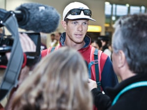 Welcome to London! US athlete surrounded by media as he lands at Heathrow airport. Photograph: PR/Michael Leckie