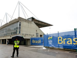 A security guard handles the crowds outside the Crystal Palace Stadium in south London, where the Brazilian Olympic team will be based during the Games. Photograph: REUTERS/Olivia Harris