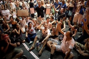 Tel Aviv protests: Israelis sit in the streets as their protest blocks a highway