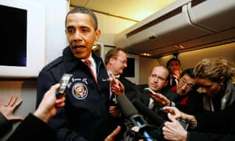 Obama speaks to reporters on Air Force One