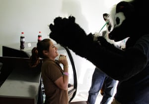 Furros Nuevo Leon: Leo and Adrian, dressed as wolves, share a moment with a barista
