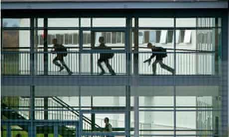 Pupils running in school