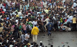 Rajesh Khanna funeral: Indian police try to control a huge crowd during a funeral procession