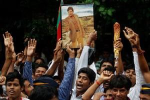 Rajesh Khanna funeral: Fans hold a photograph of Bollywood superstar Rajesh Khanna