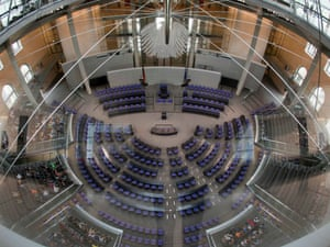 Only some visitors sit in the Germany Parliament Bundestag before a special session in Berlin, Germany, Thursday, July 19, 2012.