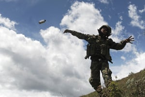 Civil unrest in Colombia: A Colombian soldier throws a tear gas cannister in Mount Berlin, Toribio