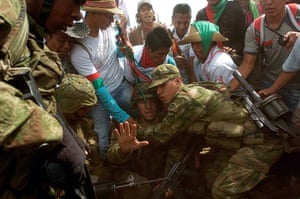 Civil unrest in Colombia: Soldiers try to lift sergeant Rodrigo Garcia as he is attacked