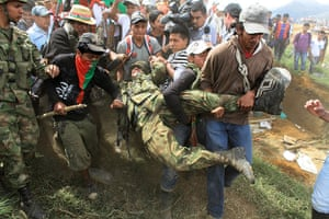 Civil unrest in Colombia: Nasa Indians drag a soldier during an attack on soldiers guarding the tower