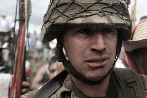 Civil unrest in Colombia: Colombian  army sergeant Rodrigo Garcia leaves with tears in his eyes