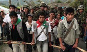 Colombia unrest: Indigenous residents escort Colombian soldiers