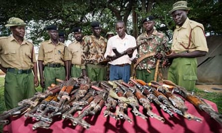Kenyan police examine guns handed in during a government-initiated voluntary disarmament programme