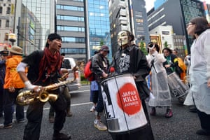 Japan nuclear protests: Anti nuclear activists take part in a demonstration on a street in Tokyo