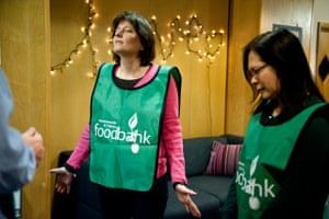 Foodbank gallery: 10 Women praying at foodbank
