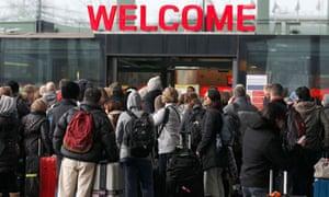 Passengers queue at Heathrow