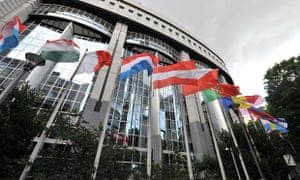 """Flags of the EU member states fly outside the European Parliament in Brussels on July 19, 2012. Eurozone finance ministers will hold a teleconference tomorrow to finalise a Spanish bank bailout deal, Luxembourg Prime Minister and Eurozone President Jean-Claude Juncker said. """"The only item on the agenda is the MOU (memorandum of understanding) for financial assistance to the Spanish banking sector """" Jean-Claude Juncker, said. Eurozone governments have pledged an initial 30 billion euros in loans by the end of the month, the first batch of a maximum 100 billion euros offered to help Madrid overcome a banking crisis. AFP PHOTO/ GEORGES GOBETGEORGES GOBET/AFP/GettyImages HORIZONTAL"""