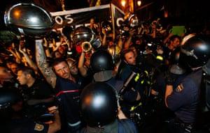 Picture desk live: Firemen confront Spanish National Police