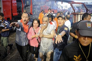 Picture desk live: Thai firemen and rescue workers help victims