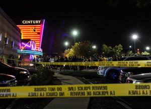 Picture desk live: People gather outside the Century 16 cinema in Aurora, Colorado