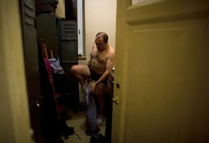 From the agencies: Jose Manuel Abel dresses in the staff changing room of the restaurant
