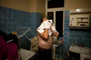 From the agencies: Jose Manuel Abel drys his face in the staff bathroom of the restaurant