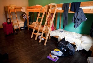 From the agencies: Jose Manuel Abel makes his bed in a hostel during his first day in Munich