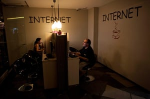 From the agencies: Jose Manuel Abel surfs the internet in the hostel