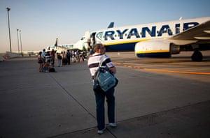 From the agencies: Jose Manuel Abel walks to his Ryanair flight