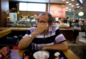 From the agencies: Jose Manuel Abel wipes away his tears as he waits to catch a flight