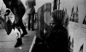 A man giving money to a homeless man