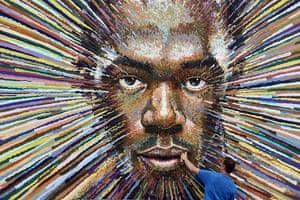 picture desk live update1: James Cochran's Artwork Of Runner Usain Bolt