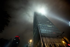 Beijing flooding: The China World Trade Center Tower III is seen during heavy rainfall