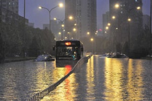 Beijing flooding: Vehicles trapped in a flooded street