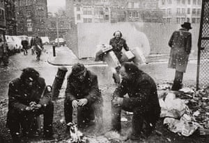 Another London: People around a fire, Spitalfields Market, London 1976