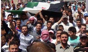 Demonstrators hold opposition flag, Syria