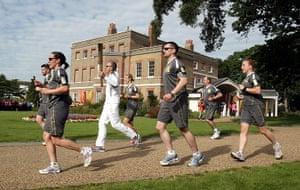 Olympic Torch 65: David Backhouse carrying the Olympic Flame past Valentine's Mansion