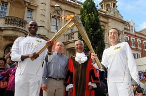 Olympic Torch 65: Luke Williams passes the Olympic Flame to Torchbearer