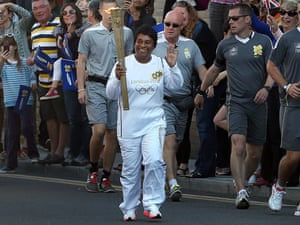 Doreen Lawrence with the Olympic torch on 23 July 2012. Photograph: Peter Macdiarmid/Getty Images