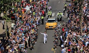 Crowds greet the Olympic torch in Croydon on 23 July 2012.
