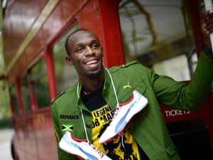 Usain Bolt poses with a London bus. Photograph: Dylan Martinez/Reuters