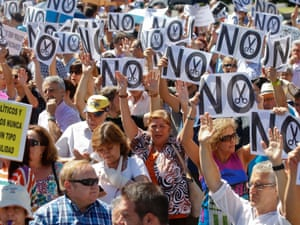 Civil servants hold up placards as they protest against government austerity measures in Madrid. Reuters/Andrea Comas