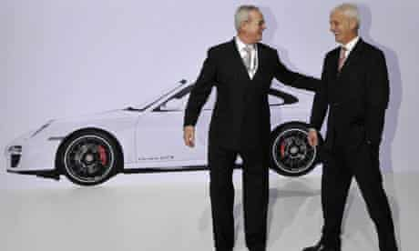 Martin Winterkorn and Matthias Mueller at an annual meeting of the Porsche Automobil Holding SE