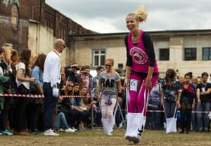 Hipster Olympics: People compete in a canvas bag jumping event