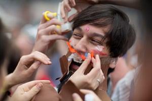 Hipster Olympics: Participants fix a fake beard on a man