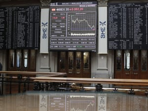 Electronic display screens at the Spanish Stock Exchange index, showing the IBEX 35.