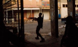 Rebel fighters clash with government forces in the old city of Dair al Zour in Syria