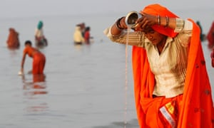 A female Hindu pilgrim offers prayers in the Ganges river