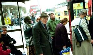 Old people boarding bus