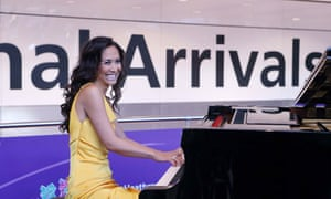 Myleene Klass performs Vangelis's Chariots of Fire for incoming passengers at Heathrow 25 July 2012