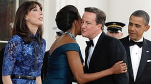 Politicians kiss: The Obamas and the Camerons at the White House, March 2012