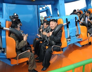 Kim Jong-un and wife: Kim Jong Un rides on one of the amusements
